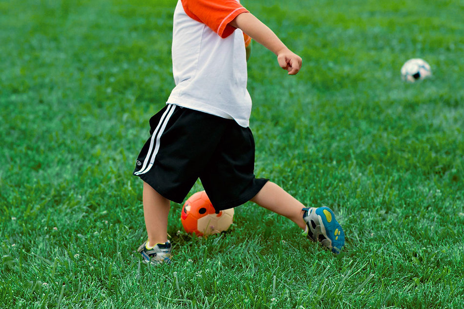 young_orange_kid_kickidaball_soccer_ball