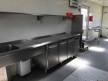Inrichting Mobiele keuken container met rvs en apparatuur