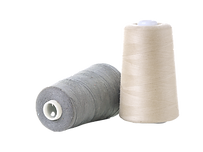 Two%20cotton%20thread%20spools%20on%20wh