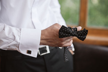 Groom getting dressed and preparing for
