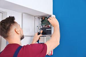 Electrician installing alarm system.jpg