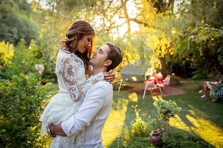 Groom-holding-his-bride-488754862_5472x3648.jpeg