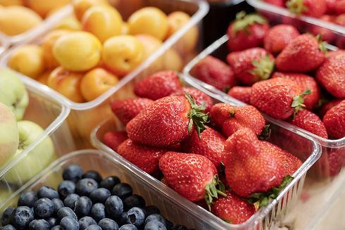close-up-fresh-fruits-berries-plastic-co