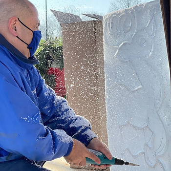 Kevin carves a reindeer out of a block of ice using a specialized ice sculptor's drill