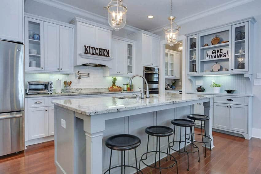 traditional-kitchen-with-white-painted-solid-wood-cabinets-gray-island-granite-countertops