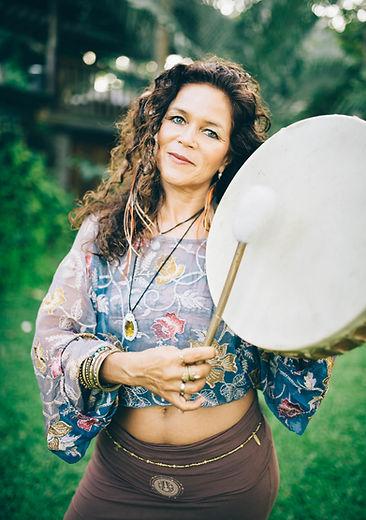 Malaika Darville playing drum
