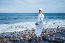 Man at Bali sea beach