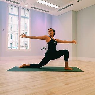 London yoga expert Rebekah Jade stretches in bright studio