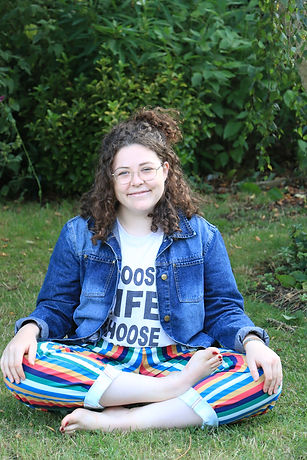 Accessible and inclusive yoga instructor Hebe Richardson relaxing in nature