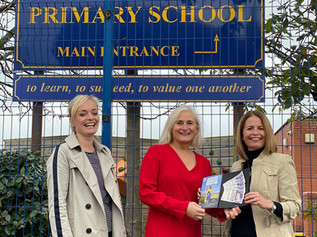St Luke's primary school receive their first £100 donation from local company