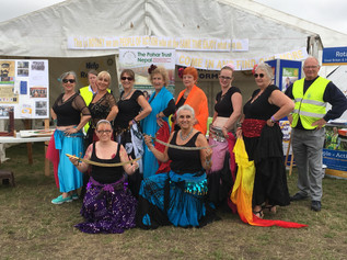 Belly Dancers storm Formby festival stall