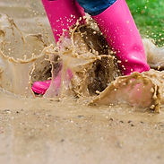 young-woman-with-rubber-boots-jumping-pu