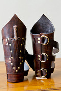 Bracers, triple banded with single dagger