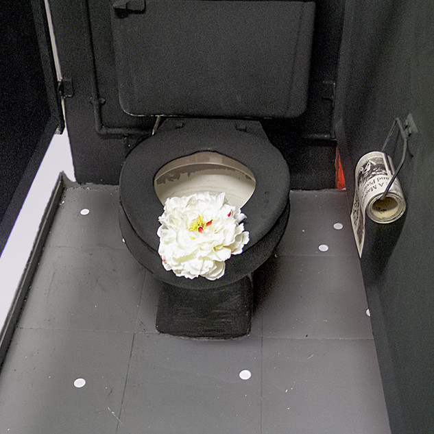 Black Toilet and Flowers with Pollock Krasner New York Times Toilet Paper
