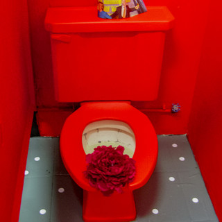 Red Toilet and Flowers, with Hilary and Bill Clinton Newspaper Toilet Paper