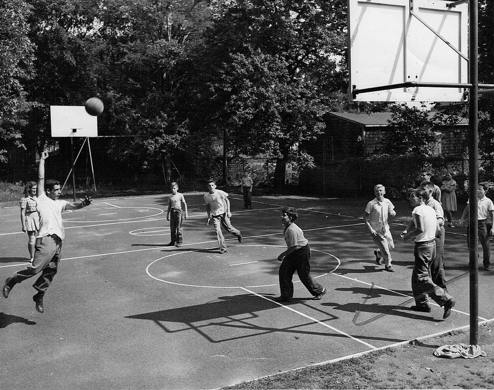 A pickup basketball game on the ever popular basketball court at Frothingham Park.