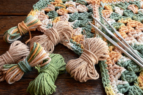 A top view image of crochet yarn and cro