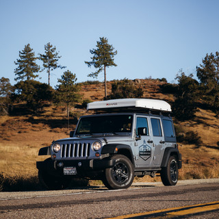 Jeep with Roof Top Tent