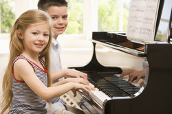 kids on the piano