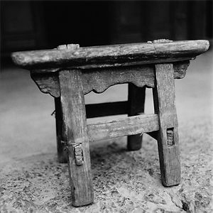 Portrait of an old, handmade chair in China.