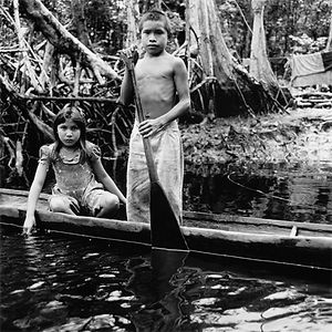 two rural village children in their boat on the Rio Cuara, Venezuela