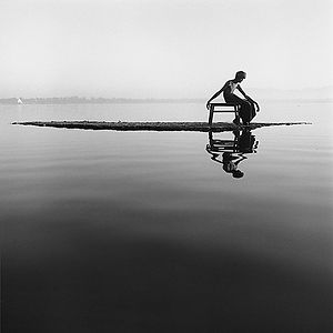 isolated young man on a small island in the river in Burma/Myanmar