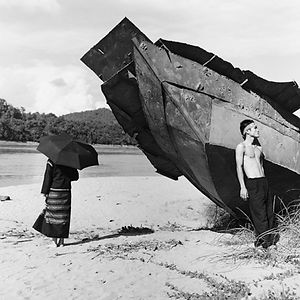rusted, beached ship and two people near Luang Prabang, Lao/Laos