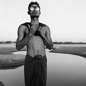 lean young man wearing sunglasses in Burma/Myanmar