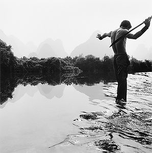 martial artist with sword in Li River, China