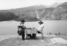 two people dining at small table overlooking an Andean lake in Ecuador