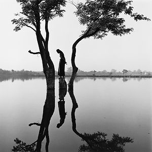 calm reflection of man and trees in Burma /Myanmar