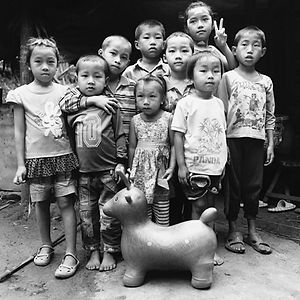 rural village children with cute toy near Luang Prabang, Lao/Laos