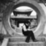 Man sitting in classic Chinese architecture
