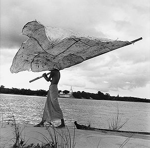 young man carrying sail like a flag in Burma/Myanmar