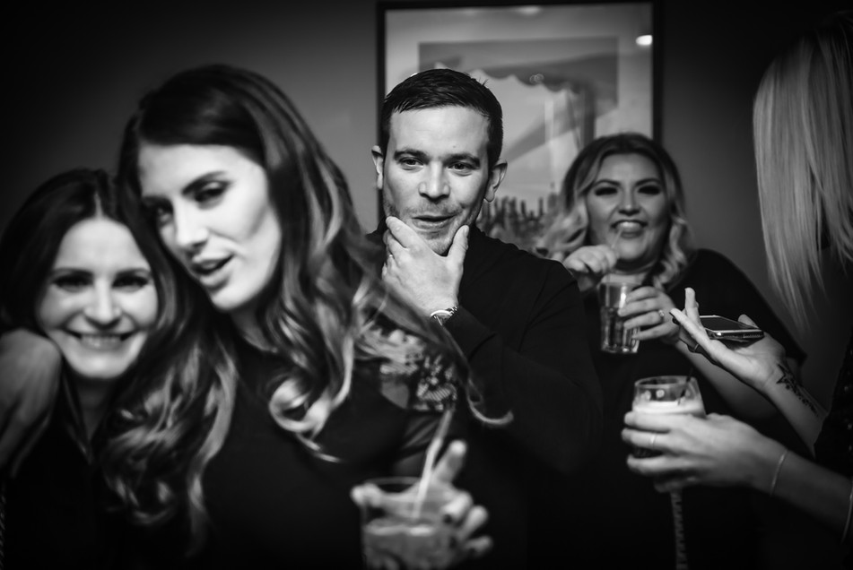 documentary photographer captures party guests drinking and enjoying themselves in Surrey