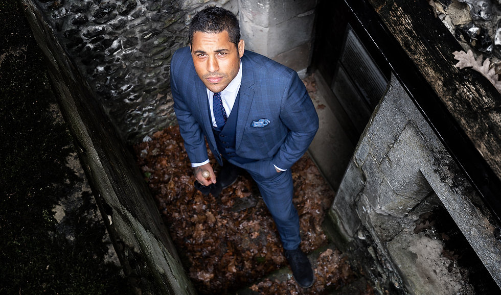 Photography Portrait of Business man in blue suit looking up on location in Surrey