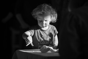 reportage lifestyle image of a child at a family event in Surrey