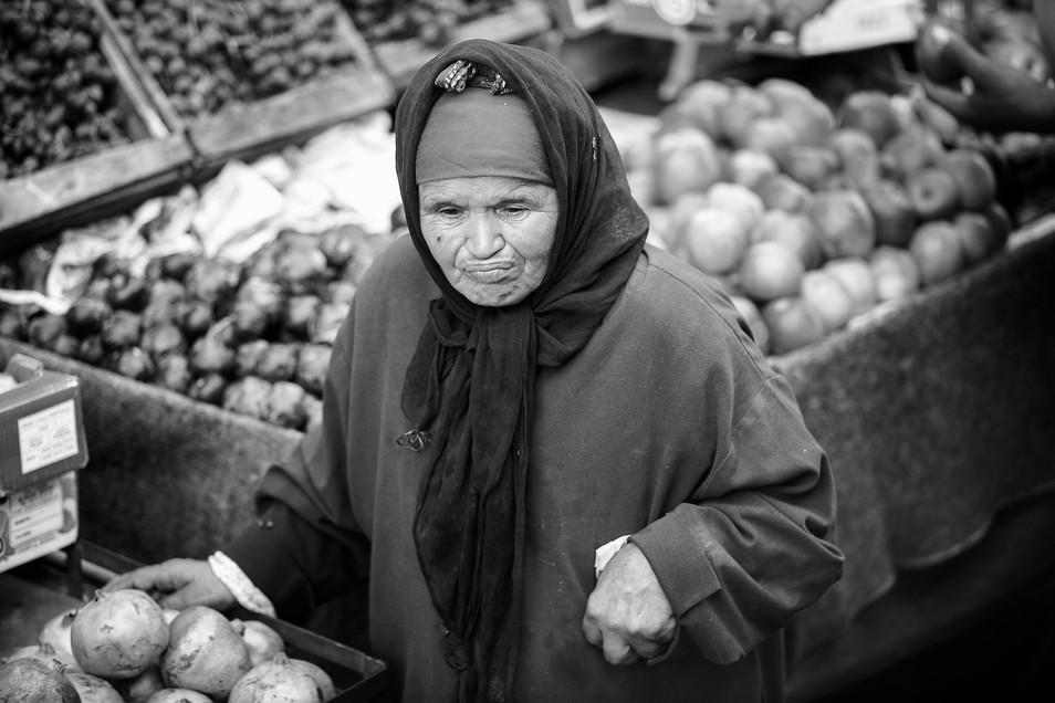 morroccan woman selling here veg at a morroccan market