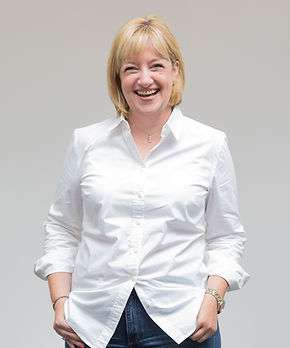 Business woman in white blouse laughing during headshot photoshoot in SurreyBusiness woman laughing during headshot photoshoot