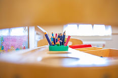 creative shot of coloured pencils in a pot for Nursery promo photoshoot
