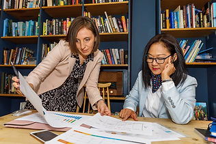 two business woman discuss paperwork at personal branding photoshoot south west london