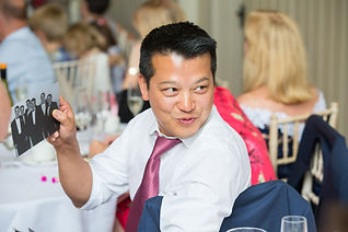Man socialising at event in Surrey