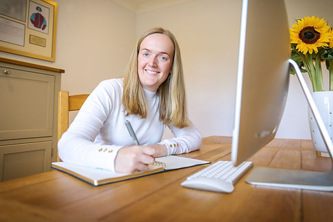 entrepreneur business woman woking at her home desk for personal branding photoshoot in Surrey
