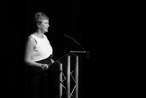 business woman talking at conference event podium in Surrey