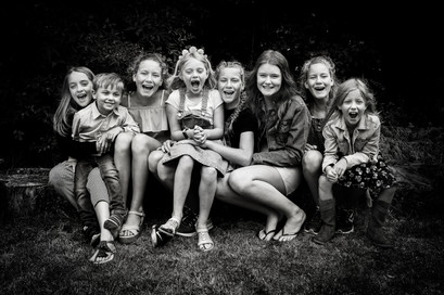 documentry family portriat photoshoot of all the children in the garden in Surrey
