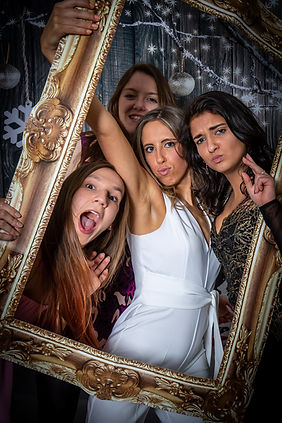 Selfie of party girls in frame photo booth style
