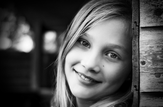Family lifestyle portrait of a young girl smiling in Surrey