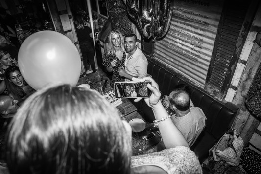 Birthday celebrations at Poor Boys restuaraunt in Kingston captured by event photographer