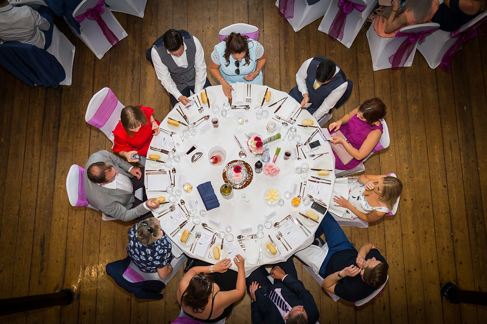 aerial shot of event guests sit around banquet table in Surrey