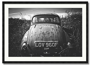 Black and White wall art of old rusty morris minor in a field Cornwall
